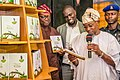 Dr. Adetolu Ademujimi's 2018 book launch in honour of Bashorun Rotimi Obeisun, with GovernorRauf Aregbesola presenting the book.jpg