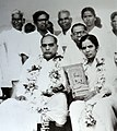 Dr Babasaheb Ambedkar with his second wife Dr Savita Ambedkar, holding a statue of the Buddha, during the Dhamma Diksha ceremony in Nagpur. October 14, 1956.jpg