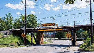 11 foot 8 Bridge - The warning signs and flashing lights at the Gregson Street Railroad Bridge, which are frequently ignored. (This photograph was taken prior to the installation of traffic signals on this side of the bridge)