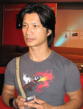 Dustin Nguyen at a press conference at the 2007 Bangkok International Film Festival, looking to the left, wearing a grey shirt