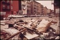 EMPTY LOT STREWN WITH TRASH AT 108TH STREET AND LEXINGTON AVENUE, MANHATTAN - NARA - 549785.tif
