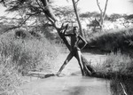 ETH-BIB-Nackter Knabe in einem Bach in der Serengeti-Kilimanjaroflug 1929-30-LBS MH02-07-0387.tif