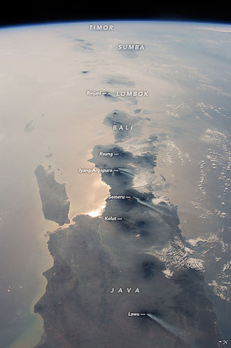 Geography of Indonesia - Java and eastern Indonesia photographed in 2015 by an astronaut on the International Space Station. Six active volcanos are visible. Haze is from wildfires.