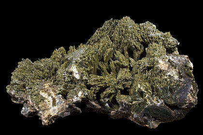 Epidote often has a distinctive pistachio-green colour. Epidote Oisans.jpg