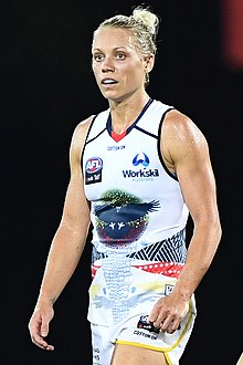 Close-up photo of Phillips in an Adelaide away guernsey