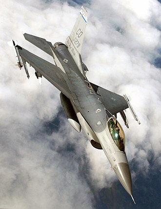 General Dynamics F-16 Fighting Falcon - An F-16C of the Colorado Air National Guard with AIM-9 Sidewinder missiles, an Air Combat Maneuvering Instrumentation pod, and a centerline fuel tank (300 gal capacity).