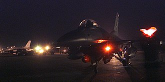 410th Air Expeditionary Wing - F-16 Fighting Falcons from the 410th Air Expeditionary Wing taxi in after a long reconnaissance mission at a forward-deployed location supporting Operation Iraqi Freedom