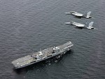FA-18 Super Hornets fly over HMS Queen Elizabeth (R08) on 5 August 2017 (170805-N-NO901-279).JPG