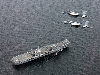 HMS Queen Elizabeth (R08) - A pair of Super Hornets from USS George H.W. Bush overfly Queen Elizabeth during Exercise Saxon Warrior in 2017
