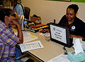 FEMA - 44426 - A resident speaks with a FEMA reresentaive at a Disaster Recovery Center in Tennessee.jpg