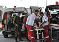 Flickr - Israel Defense Forces - Injured Palestinian Transferred Through Qalandiya Crossing.jpg