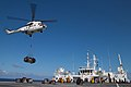 Flickr - Official U.S. Navy Imagery - A helicopter readies itself to deliver cargo..jpg