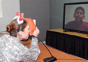 Flickr - The U.S. Army - Multi-National Division - Baghdad Soldiers talk to their children over video teleconference