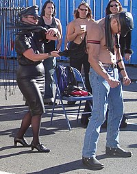 Flogging demonstration at Folsom Street Fair 2004.