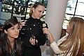 Gabi Lopes entrevista a maquiadora enquanto ela embeleza a Nah Cardoso @ São Paulo Fashion Week em Junho de 2011.jpg