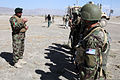 General Muhammed Naseer, left, battalion commander of Afghan National Army, holds a formation and talks to his troops during Operation ShamShir in Paktiya province, Afghanistan, Oct, 19, 2011 111019-A-DH574-031.jpg