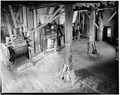 General view of first floor showing one roller mill and three baggers. - Fisher-Fallgatter Mill, Waupaca, Waupaca County, WI HAER WIS,68-WAUP,1-9.tif