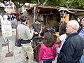 Gente observando el trabajo con el yunque, Alcalá de Henares, Madrid, España, 2015.JPG