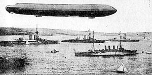 1914 in aviation - A German dirigible hovering over a British fleet.