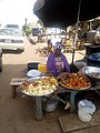 Girl selling local snacks by the roadside, Ilorin, Kwara State.jpg