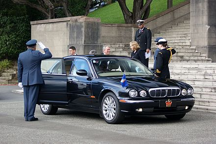 The official vehicle of Government House in 2010, a Jaguar XJ8. During official travel it is the only vehicle in the country not required to use standard number plates. Governor-General of New Zealand Jaguar XJ8 Battle of Britain 70th commemorations.jpg