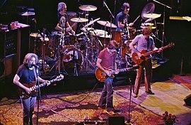 The Grateful Dead 1980. Left to right: Jerry Garcia, Bill Kreutzmann, Bob Weir, Mickey Hart, Phil Lesh.  Not in the photo: Brent Mydland