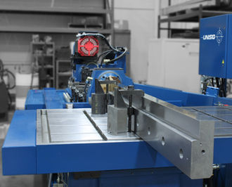Gun drill - A gun drilling machine drilling holes in steel.