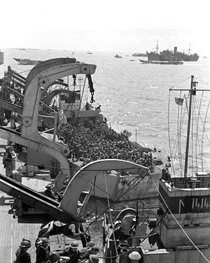 HMCS Prince David (F89) - A second section of infantrymen preparing to go ashore from Prince David off Bernières-sur-Mer, France, 6 June 1944.