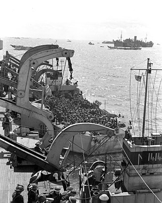 HMCS Prince David (F89) - A second section of infantrymen preparing to go ashore from Prince David off Bernières-sur-Mer, France, 6 June 1944.