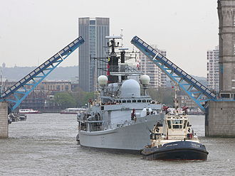 HMS Edinburgh (D97) - HMS Edinburgh being towed under Tower Bridge on a visit to London just prior to decommissioning.