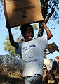 Haitians Receive Boxes of USAID Food Aid (4295901823).jpg
