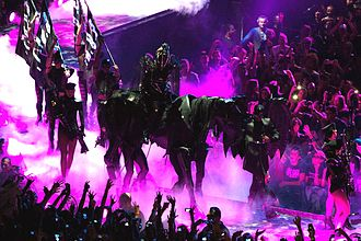 "Born This Way Ball - Lady Gaga opening the show with the performance of ""Highway Unicorn (Road to Love)"" atop a fully puppeteered horse"