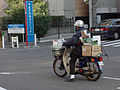 Honda Super Cub with boxes of papers.jpg