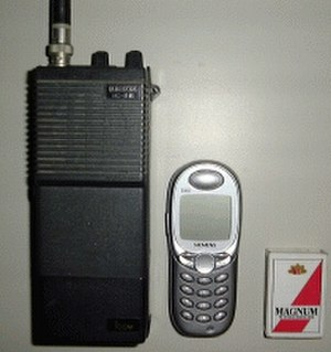 Radiotelephone - Comparison of an amateur radio handheld transceiver, cell phone, and matchbox