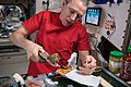 ISS-56 Drew Feustel prepares a meal inside the Unity module.jpg