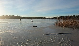 Sollentuna Municipality - Ice skating on Lake Norvikken in winter.
