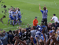 IFK Göteborg and their fans celebrate a goal against Örebro SK in 2004.
