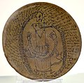Incantation bowl, from Iraq, Aramaic inscription with a human figure and snakes. 3rd to 7th century CE. Iraq Museum.jpg