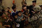 Iraqi Police Distribute School Supplies to children in Mosul, Iraq DVIDS181313.jpg