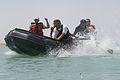 Iraqi policemen celebrate after winning a paddle race on Lake Quadsiyah in Haditha, Iraq, July 9, 2008 080709-M-QJ743-006.jpg