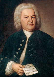 Johann Sebastian Bach 1746, mit Rätselkanon (Ölgemälde von Elias Gottlob Haußmann)[1] (Quelle: Wikimedia)