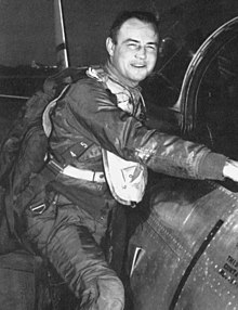 Hagerstrom posing in his flight suit while climbing into the cockpit