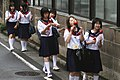 Japanese schoolgirls walking and eating.jpg