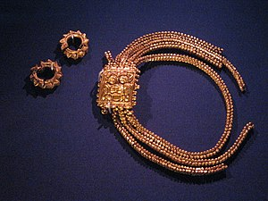 Kingdom of Singapura - 14th-century gold armlets and rings in East Javanese style, found at Fort Canning Hill, Singapore, displayed in the Singapore History Gallery of the National Museum of Singapore