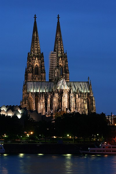 Cologne Cathedral, finally completed in 1880 (though construction started originally in 1248) with a facade 157 metres tall and a nave 43 metres tall Kolner Dom abends.jpg