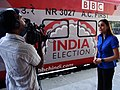 Karishma Vaswani does a piece to camera at the launch of the Indian Election train (3534963549) (2).jpg