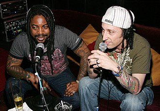 Sevendust - Lajon Witherspoon (left) and Morgan Rose (right)