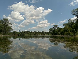 Lake of the Isles - The lake seen from the south in July, with birdlife sanctuary islands on the left and right