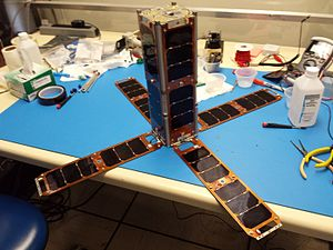 Small Satellite Program (United States Naval Academy) - USS Langley after vibe table testing with fully deployed solar panels.