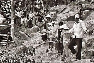 Joint POW/MIA Accounting Command - Laotians hired to assist U.S. troops sift then move tons of dirt on a mountain near Xepon, Laos (July 2004). This particular mission involved searching for the human remains of two F-4 Phantom crewmen who crashed after a bombing run over Vietnam.